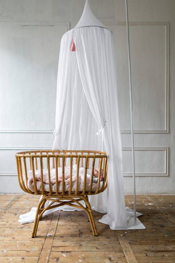 Florence under powder pink blanket with Canopy pink tassels